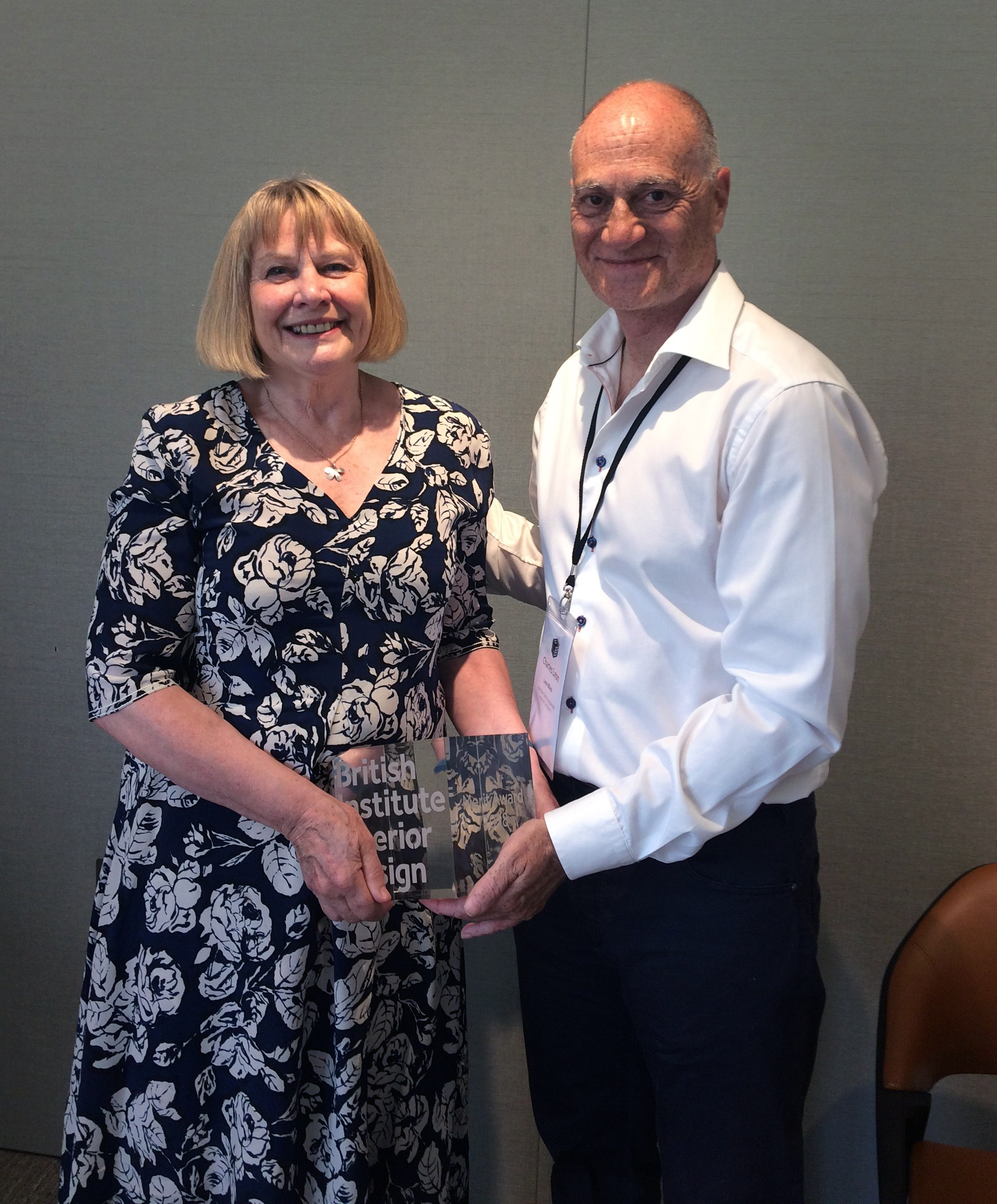 Janet Jones receiving Merit Award 2018, with BIID Past President Charles Leon